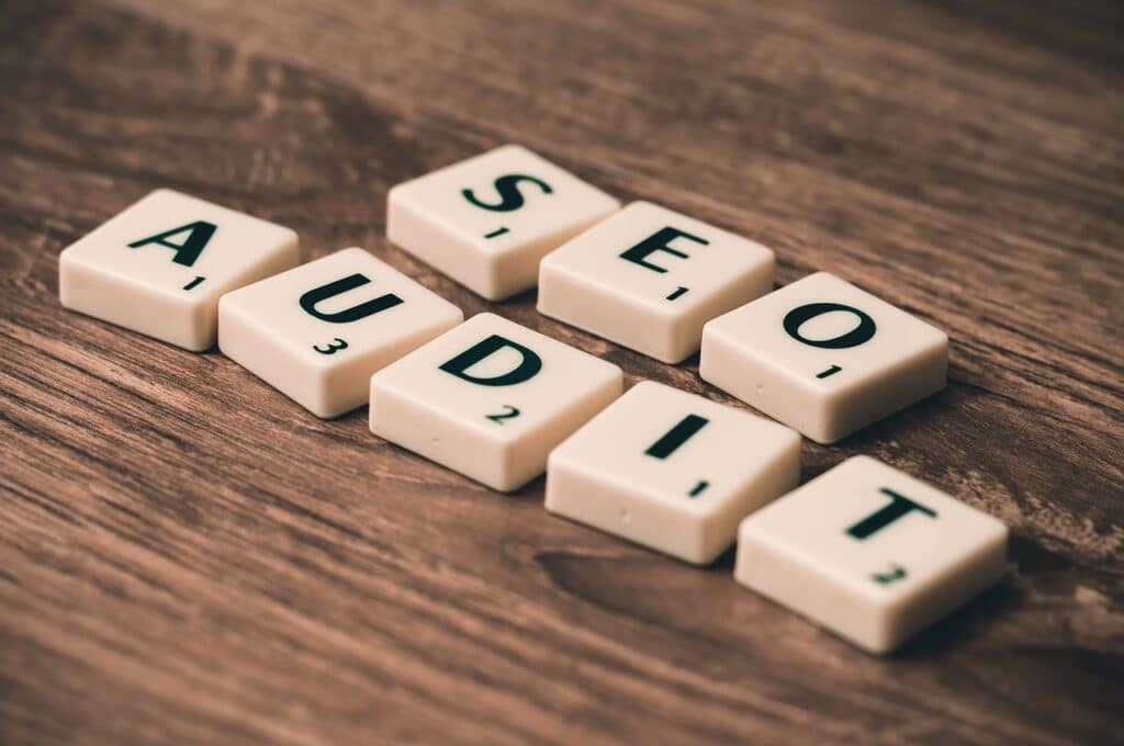 """The """"SEO Audit"""" words, made of scribble tiles."""